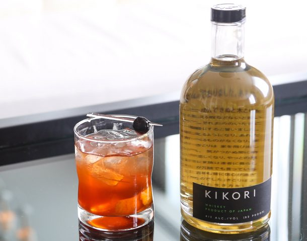 Photo of Kikori whisky bottle next to an old fashion