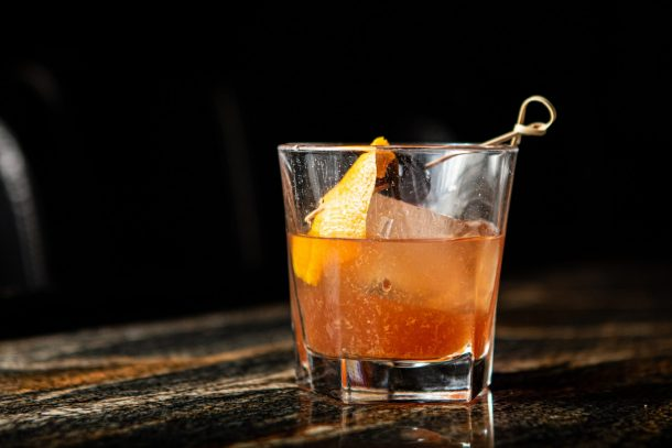 Old fashioned drink with dark background