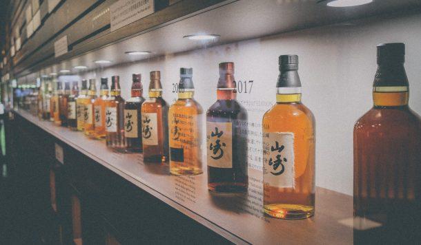 A lineup of Suntory whisky bottles