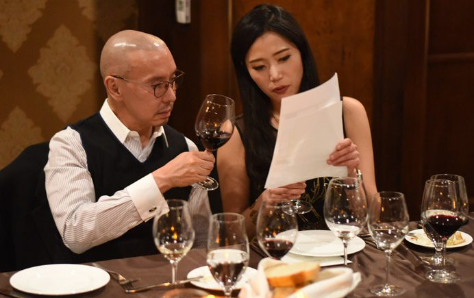 Changyu Moser Tasting Dinner couple looking over menu